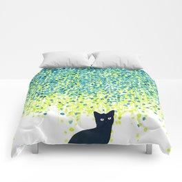 Cat in the garden under willow tree Comforters