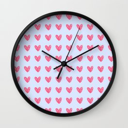 Pink hearts on blue Wall Clock