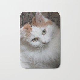 Fluffy white-haired cat. Portrait Bath Mat