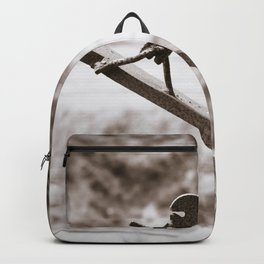 Metal Figure Walking Down Backpack