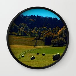 The battle of bales Wall Clock