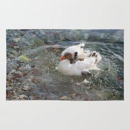 Duck Splashing Water Creating Ripples on Riverbank Rug