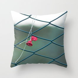 Deflated red balloon on fence net Throw Pillow