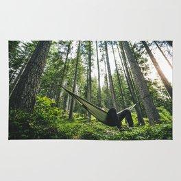 man resting on the hammock Rug