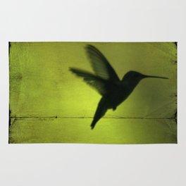 Neon Green Hummingbird behind the blinds Rug