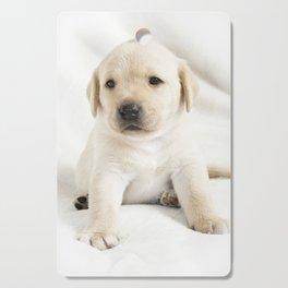 Golden labrador puppy Cutting Board