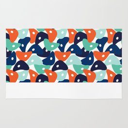 Rolly Polly Fish Heads Blue Rug