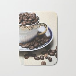 Coffee beans in the old cappuccino cup Bath Mat