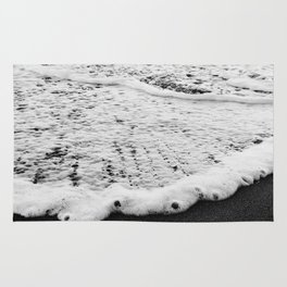 Rushing in - black white Rug
