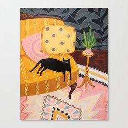 black cat on mustard yellow sofa painting by Tascha Canvas Print