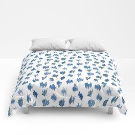 Brushstrokes of blue paint Comforters