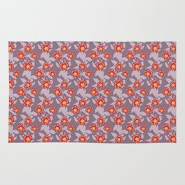 Hibiscus and pomegranate flowers in purple Rug
