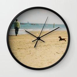 Dachshund on the beach Wall Clock
