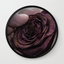 Hand Clutching a Dying Rose Wall Clock