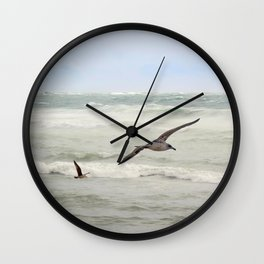Seagulls flying over rough sea Wall Clock