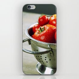 fresh tomatoes (in metal colander) and herbs on a wooden table iPhone Skin