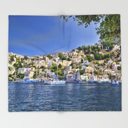Symi island in Greece. Traditional houses. Sunny day with blue sky and sea. Throw Blanket