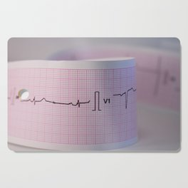 Approach and defocus an electrocardiogram strip. Record of the electrical activity of the heart. Cutting Board