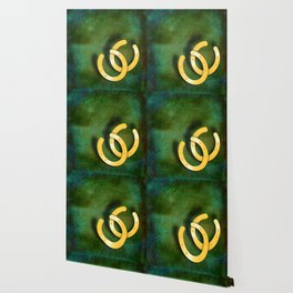Lucky horseshoes on a textured green background Wallpaper