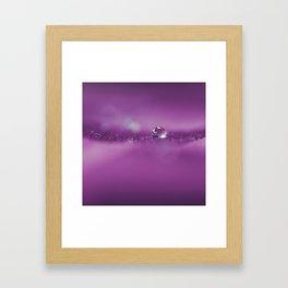 a drop in purple Framed Art Print