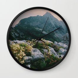 Mountain flowers at sunrise Wall Clock