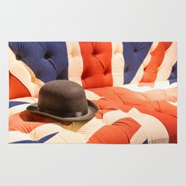 Black Bowler Hat on Union Jack Chesterfield Sofa Rug