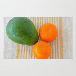 Fruit avocado and oranges. Rug