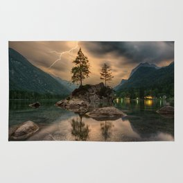 A scenic lake with Mountains & Lightning in the Distance. Rug