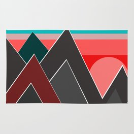 Red sunset over dark mountains. Rug