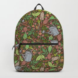 Garden tool with leaves and clover on brown background Backpack