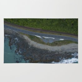 kaikoura coastline vertical view by drone camper serpentines Rug