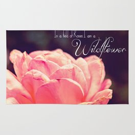 In a field of roses I am a wildflower Rug