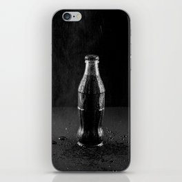 Glass bottle with carbonated drink under the drops of water. iPhone Skin