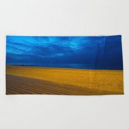 A night at the beach Beach Towel