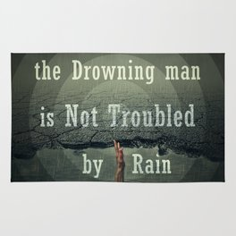 the drawning man is not troubled by rain Rug