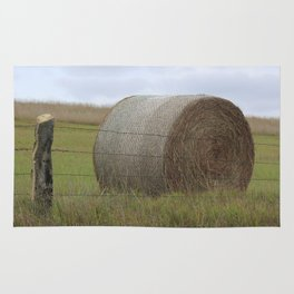 Kansas Hay Bale in a field with a fence Rug