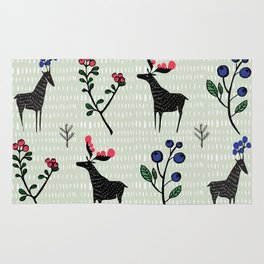 Berry loving deers on a green background Rug