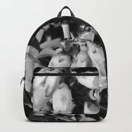 Tiny Blossoms On A Dirt Road in Black and White Backpack