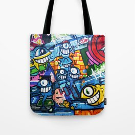 Graffiti Urban colorful graffiti city wall comical cartoon fish with big eyes doing graffitis Tote Bag