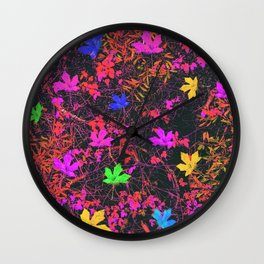 maple leaf in yellow green pink blue red with red and orange creepers plants background Wall Clock