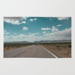 cows on the open road Rug