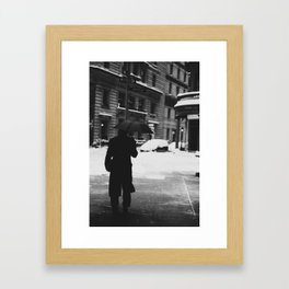 man in the snow with umbrella Framed Art Print