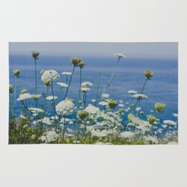 Flowers by the Beautiful Blue Sea Rug