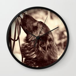 The love of a dog to man Wall Clock