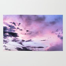 fly up to the blue pink sky Rug