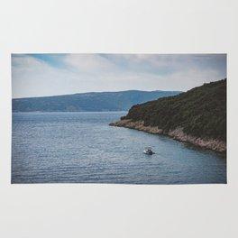 Boat leaving Valbiska bay Rug