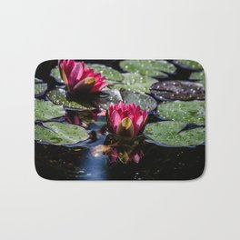 Two water lilies in the sunbeam Bath Mat