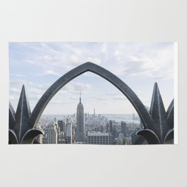 Empire State seen through an iron fence Rug