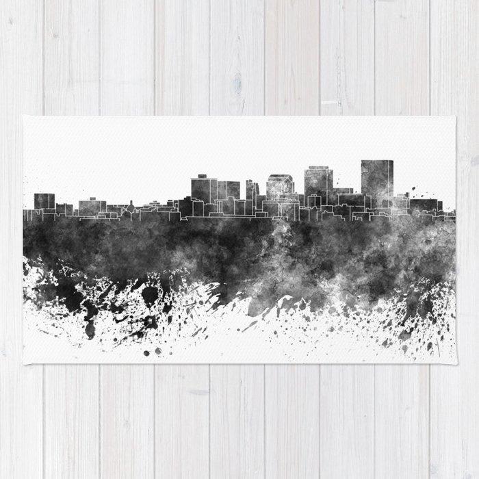 Dayton skyline in black watercolor on white background Rug