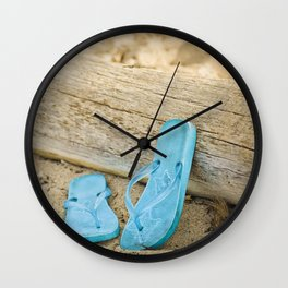 sandals against driftwood Wall Clock